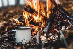 Making coffee at the stake. Make coffee or tea on the fire of nature. Burned fire. A place for fire. Ashes and coal.