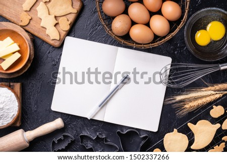 Making cookies cookbook recipe design concept, baking ingredients preparation layout with notebook, top view, flat lay, overhead, mockup copy space.