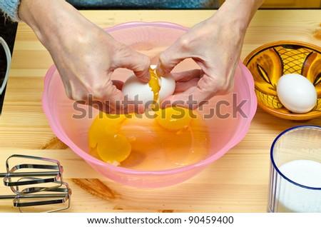Making cookies. Cracking eggs. #90459400