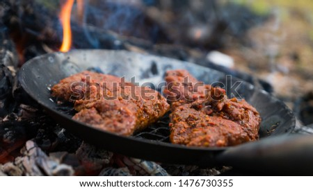 Making delicious stakes with open fire #1476730355