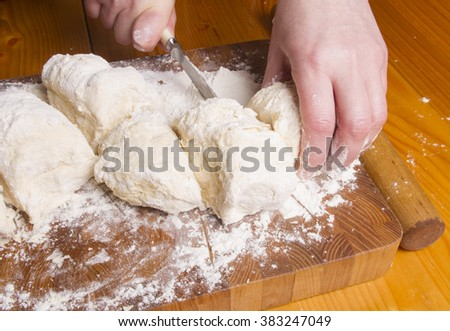 Making dough by female hands on wooden table background - Shutterstock ID 383247049