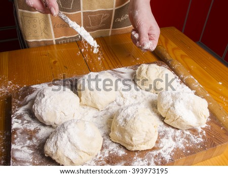 Making dough by female hands on wooden table background - Shutterstock ID 393973195