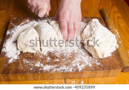 Making dough by female hands on wooden table background - Shutterstock ID 409235899