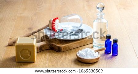 making economic dish washing detergent with pure essential oils, healthy soap, natural and biodegradable baking soda for DIY green cleaning