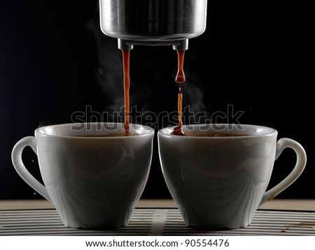 Making espresso coffee in two cups