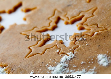 Making gingerbread cookies for Christmas. Gingerbread dough with star shapes.