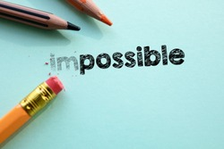 Making impossible in to possible by eraser. Cencept for action and reaching goals.