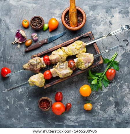 Making kebabs from meat-raw meat on skewers.Raw meat is cooked for shish kebab