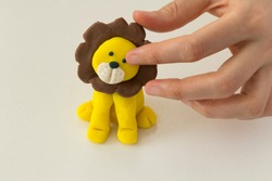 Making lion animal step by step with play dough for children's activity in the school art lesson and plasticine concept.