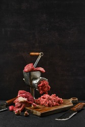 Making minced beef meat with oldfashioned meat grinder