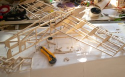 Making model airplane from balsa wood. handcrafted on work table