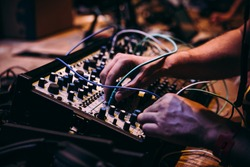 Making music using modular synthesizers. Electronic music and professional music equipment concept.