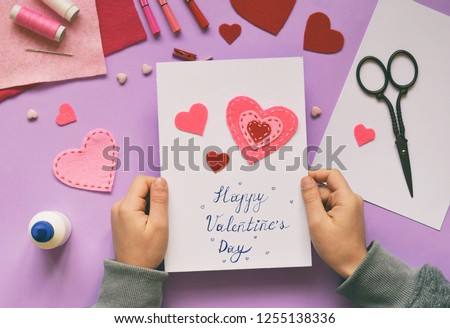 Photo of  Making of handmade Valentine greeting card from felt. Children's DIY, hobby concept, gift with your own hands. Valentine's Day decoration.