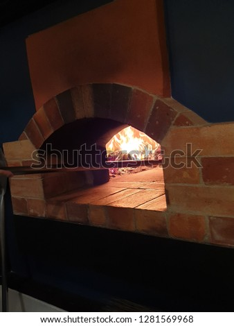 Making Original Wood-fired pizza oven #1281569968