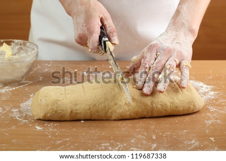 Making Pastry Dough for Hungarian Cake. Series. A baker cutting dough.