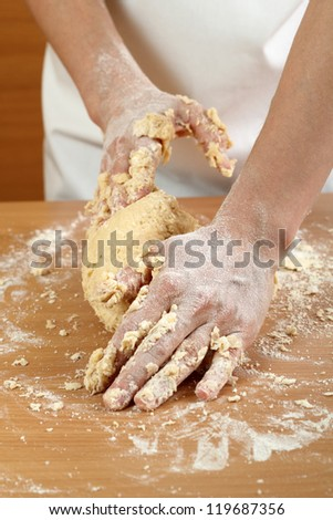 Making Pastry Dough for Hungarian Cake. Series. A baker kneading dough.
