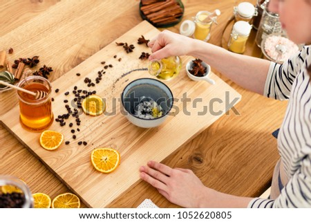 Making soap at home on the countertop filled with honey, oranges and cinnamon