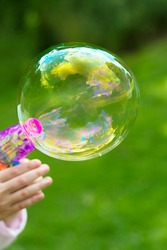 Making soap bubble outdoor. Summer fun activity for kids, abstract education, play games concept.