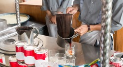 Making Thai milk tea  using coffee bag in Stainless Steel Pot.