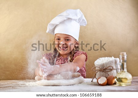 Making the dough for pizza is fun little chef playing with flour