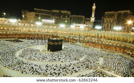 MAKKAH - APRIL 24 : Muslims in prostration during prayer facing the Kaaba at Masjidil Haram on April 24, 2010 in Makkah, Saudi Arabia. Muslims all around the world face the Kaaba during prayer time.