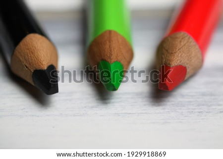 Makro closeup of group isolated colorful crayons on white wood table (focus on green pencil tip) Stock foto ©