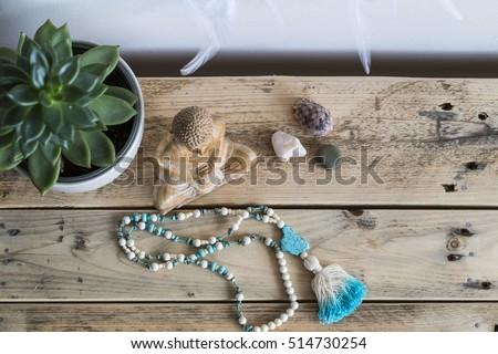 Mala and wooden buddha Stock photo ©