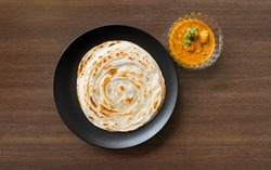 Malabar fresh homecooked parotta, handmade recipe, paneer curry side dish. Authentic south indian food.