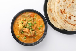 Malabar parotta with kurma, paratha kurma is a delicacy from the state of Kerala, tamilnadu south India. kurma is mixed veg south Indian curry