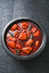 Malabar red fish curry is a hot and spicy seafood cuisine masala gravy Alappuzha India. cooked with ingredients curry leaves, tamarind and coconut milk.Rice and fish is a popular dish  in coastal area