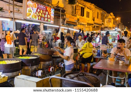 Malacca, Malaysia - August4, 2018: The stall of many shops around Jonker Walk street , China town in Malacca, Malaysia in the night time of April 2015. #1155420688