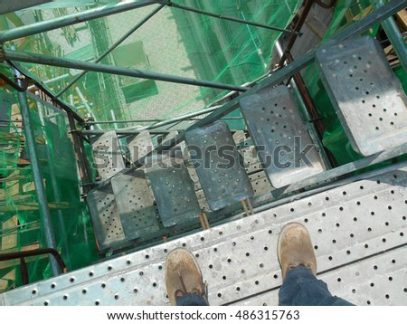 MALACCA, MALAYSIA -MAY 04, 2016: Temporary access and staircase supported by reinforced scaffolding at the construction site.  #486315763