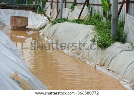 MALACCA, MALAYSIA � SEPTEMBER 28, 2015: Check dam or silt trap at the construction site. Soil and mud from the construction site in strained and precipitated here.  #366580772