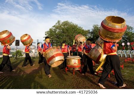 MALACCA - NOVEMBER 1: Drummers preparing for their performance at the annual Chong Yang festival on Bukit Cina. November 1, 2009 in Malacca, Malaysia.