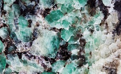 Malachite in mica group of sheet silicate minerals. Natural decorative stone texture pattern macro view