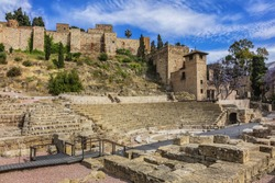 Malaga ancient ruins of Roman Theater (El Teatro Romano) at foot of famous Alcazaba fortress. Roman Theater is oldest monument in Malaga City, it was built in I century BC. Malaga, Andalusia, Spain.