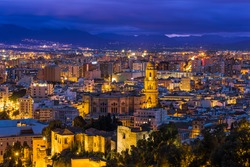 Malaga cathedral and cityscape at twilight from aerial view