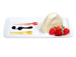 Malaga Dessert Cake and banana in chocolate sauce. White cake isolated on white background with Strawberry.
