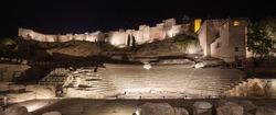 Malaga landmarks on night. Roman theater ruins and alcazaba. Andalusia, Spain, Europe.