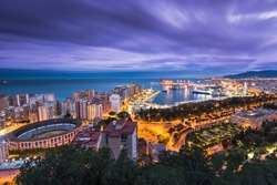 Malaga panoramic cityscape at evening at Costa del Sol in Andalucia,Spain