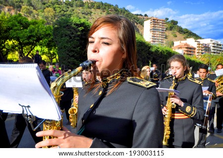 MALAGA, SPAIN - APRIL 09: Nazarenes and musicians from Semana Santa (Easter) catholic parade in the streets in April 09, 2009 in Malaga, Spain