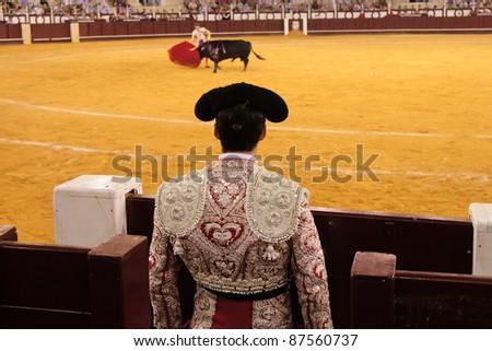 MALAGA, SPAIN - AUGUST 20: Ivan Fandino fights bull in Malagueta bullring in the traditional fair of Malaga on August 20, 2011 in Malaga, Spain
