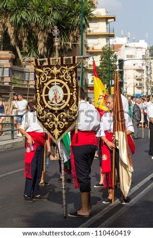 MALAGA, SPAIN - JULY 16: Unidentified local worshippers carry a religious banner during the 'Virgen del Carmen' procession on July 16, 2012 in Malaga, Spain.