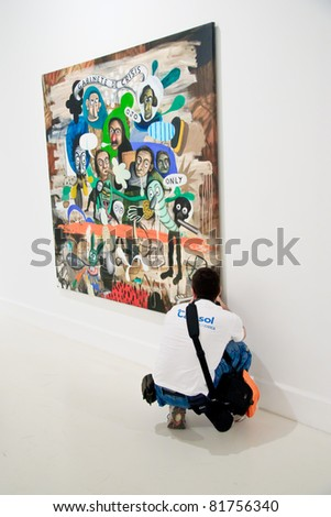 MALAGA,SPAIN - JUNE 11: People look at painting galleries at CAC (Contemporary Art Center),international exhibition of modern and contemporary art on June 11, 2010 in Malaga, Spain