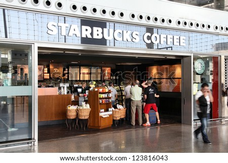 MALAGA, SPAIN - OCTOBER 14: People visit Starbucks Coffee on October 14, 2010 at Malaga Airport, Spain. With 17,800 stores it is largest coffeehouse company worldwide.