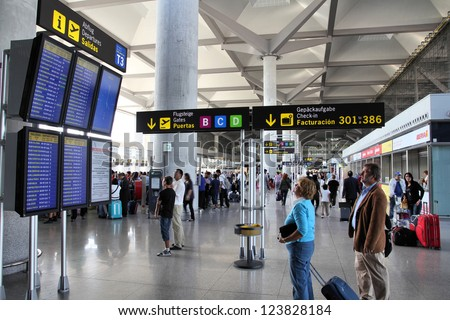 MALAGA, SPAIN - OCTOBER 14: Travelers wait on October 14, 2010 at Malaga Airport, Spain. Malaga is 4th busiest airport in Spain with 12.8 million passengers in 2011.