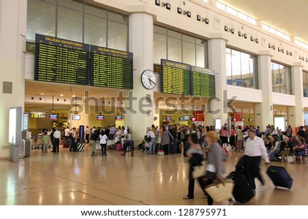 MALAGA, SPAIN - OCTOBER 14: Travelers wait on October 14, 2010 at Malaga Airport, Spain. Malaga is the 4th busiest airport in Spain with 12.6 million passengers in 2012. - stock photo