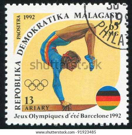 MALAGASY CIRCA 1992: A stamp printed by Malagasy, shows Women's gymnastics, circa 1992