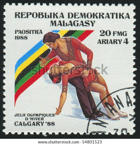 MALAGASY - CIRCA 1988:   stamp printed by Malagasy, shows professional figure skaters, circa 1988.