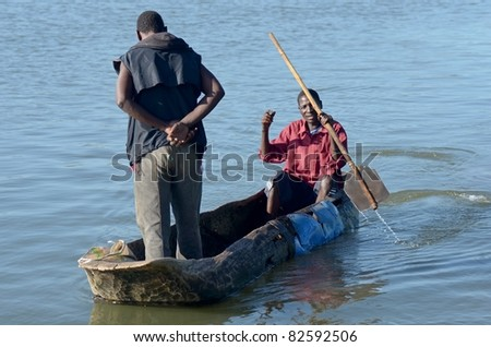 MALAWI LAKE, MALAWI- APRIL 13: Fisherman conducts a dugout obtained from a three bole in Malawi lake in Malawi, on April 13,2011. Throughout West Africa  Euphorbiaceae are used to make canoes.